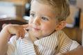 Happy baby boy at restaurant Royalty Free Stock Photo