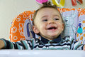 Happy baby boy sitting laughing Royalty Free Stock Photo
