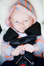 Happy baby in car seat a boy sitting a with bright blue eyes and a cute smile Stock Photo
