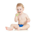 Happy baby child brushing teeth Stock Photos