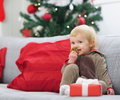 Happy baby in christmas costume eating cookie high resolution photo Royalty Free Stock Images