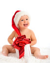 Happy baby in a christmas hat with a gift isolated on white background Royalty Free Stock Photography
