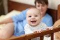 Happy baby in cot Royalty Free Stock Photos