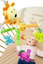 Happy baby on crib Royalty Free Stock Photo