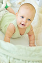 Happy baby in crib Royalty Free Stock Photo