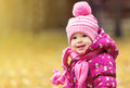 Happy baby girl child outdoors in the park in autumn on walk Stock Images