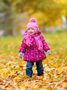 Happy baby girl child outdoors in the park in autumn on walk Stock Image