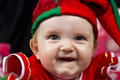 Happy baby girl in christmas outfit a dressed up as a little elf a cute Royalty Free Stock Photos