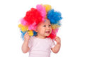 Happy baby girl with clown wig isolated on white Stock Photo