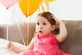 Happy baby girl in crown on birthday party at home Royalty Free Stock Photo