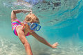 Happy baby girl dive underwater in sea pool Royalty Free Stock Photo