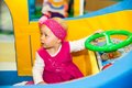 Happy baby girl keep on board ship on playground the concept of childhood and holiday Royalty Free Stock Photography