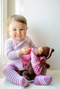 Happy baby girl plays with toy bear Royalty Free Stock Photo