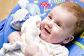 Happy baby girl with toy Royalty Free Stock Image