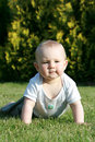 Happy baby on grass Royalty Free Stock Photo