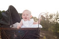 Happy baby in her pram girl is sitting a vintage Royalty Free Stock Image