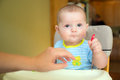 Happy baby infant boy eating meal Royalty Free Stock Photo
