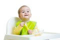 Happy baby kid waiting for food with spoon