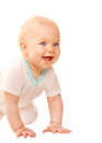 Happy baby looking out and smiling. Royalty Free Stock Photos