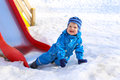 Happy baby on playground in winter funny age of months outdoors Royalty Free Stock Images