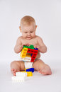 Happy baby playing in the constructor sitting on the floor little child Stock Images
