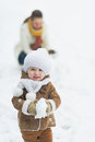 Happy baby playing with mother in winter park high resolution photo Royalty Free Stock Photo