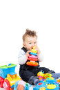 Happy baby playing with toys isolated on white Stock Photo