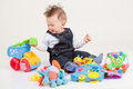 Happy baby playing with toys white background Royalty Free Stock Photography