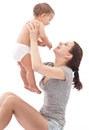 Happy baby plays with mother isolated on a white background Royalty Free Stock Images