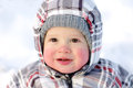 Happy baby with rosy cheeks in winter smiling year outdoors Royalty Free Stock Photos