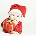 Happy baby in santa hat on background Royalty Free Stock Photos