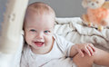 Happy baby sitting in bed looking at the camera Royalty Free Stock Photo