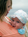 Happy baby in sling Stock Photography