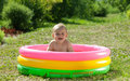 Happy baby swimming  in   pool Royalty Free Stock Photo