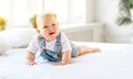 Happy baby toddler in bed Royalty Free Stock Photo