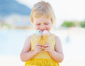 Happy baby with two ice cream horns high resolution photo Stock Photo