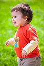 Happy baby walking outdoors Royalty Free Stock Photography