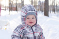 Happy baby in winter year with rosy cheeks outdoors Royalty Free Stock Image