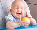 Happy baby with yellow apple newborn Royalty Free Stock Photos