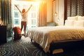 Happy backpacker traveller stay in high quality hotel Royalty Free Stock Photo