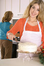 Happy baker in the kitchen Royalty Free Stock Photos