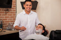 Happy barber ready to shave portrait of a handsome young holding a razor and about a man s beard Royalty Free Stock Photography