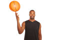 Happy basketball player spinning ball on finger portrait of a young isolated white waist up horizontal shot Royalty Free Stock Image