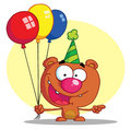 Happy bear in party hat with balloons Royalty Free Stock Photography