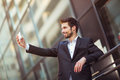 Happy bearded businessman standing outside office building Royalty Free Stock Photo