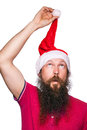 Happy bearded happy man with red hat and t-shirt, studio shot. Royalty Free Stock Photo