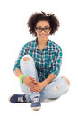 Happy beautiful african american teenage girl sitting isolated o on white background Stock Photography