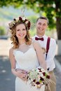 Happy beautiful bride and groom walking in sunlight Royalty Free Stock Image