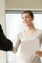 Happy beautiful businesswoman shaking businessman hand, holding Royalty Free Stock Photo