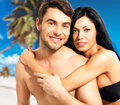 Happy beautiful couple in love at tropical beach portrait of smiling Royalty Free Stock Images